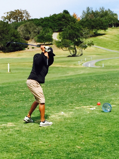 Teeing it off at the range at Village Country Club. (Photo by Scott Bridges)