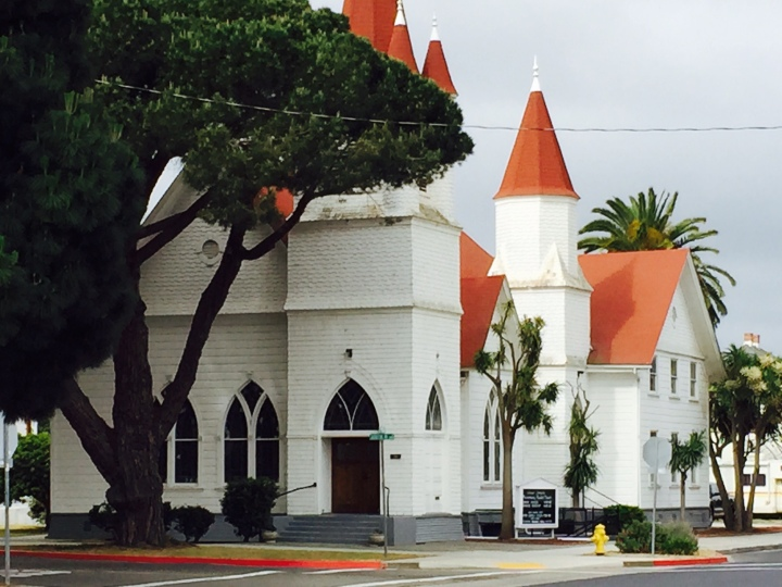 A historic church in Old Town. Note the Italian stone pine on the corner. (Photo by Scott Bridges)