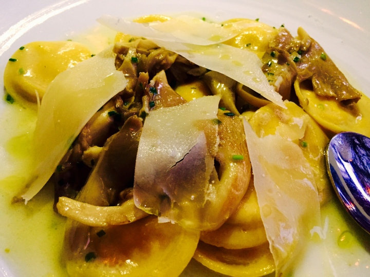 LND's summer ravioli with corn pudding, Chanterelles, chive blossom and butter sage. Photo by Scott Bridges